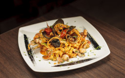 Seafood tagliatelle (squid, mussels, clams and razor clams) with tomato, chilli, garlic and parsley.