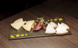 A selection of pecorino cheeses with an orange, pear and wine sauce